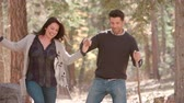 великолепный : Hispanic couple walk in forest holding hands, close up