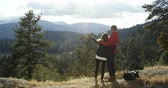 wi fi : Young couple on a road trip admire the view and take selfie, shot on R3D Stock Footage