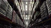 corredor : Moving along an aisle in a storage warehouse, shot on R3D