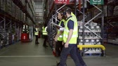 corredor : Staff walking though warehouse with manager, shot on R3D Vídeos