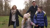 recreativa : Family walking in woods towards tracking handheld camera, shot on R3D