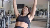 reclináveis : Woman working out with dumbbells at a gym, close up, shot on R3D Stock Footage