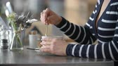 capuccino : Close up of woman's hands stirring cup of coffee in a cafe