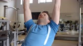 reclináveis : Man works out with dumbbells on a bench at a gym, close up shot on R3D Stock Footage
