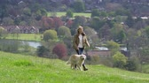 wide angle : Mature Woman Taking Dog For Walk In Countryside Shot On R3D