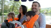 motor : Family Enjoying Day Out In Boat On River Shot In Slow Motion Vídeos