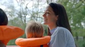 months : Mother And Sons Enjoy Ride In River Boat Shot In Slow Motion Stock Footage