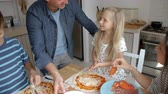etniczne : Family At Home In Kitchen Making Pizzas Together Wideo