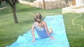 months : Father And Children Having Fun On Water Slide In Garden