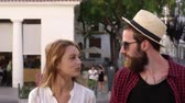 ombros : Couple on vacation talking as they walk through Ibiza town, shot on R3D