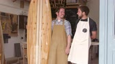 craft : Carpenter And Apprentice With Surfboard Shot