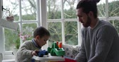 сиденья : Father And Son Playing With Toy Garage In Window Seat Стоковые видеозаписи
