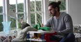 se divertindo : Father And Son Playing With Toy Garage In Window Seat Stock Footage