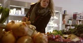 consumismo : Woman Shopping For Produce In Delicatessen Shot On R3D