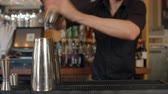 tremer : Close Up Of Barman Mixing Cocktail On Counter