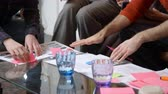 pegajoso : Close Up Of Designers Meeting Around Table In Modern Office