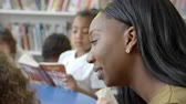 participation : Teacher And Pupils Reading In Library Shot On R3D Stock Footage