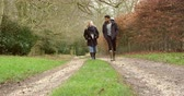 tendo : Couple Walking Along Path In Countryside
