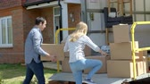 cauda : Couple Unpacking Moving In Boxes From Removal Truck