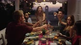 patio : Friends make a toast over dinner on a roof terrace, Ibiza, shot on R3D