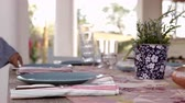 patio : Surface level shot of woman preparing dinner table on patio Stock Footage