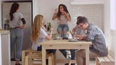 sentar se : Teenage friends, studying and talking in kitchen, shot on R3D