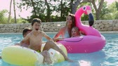 traje : Family Having Fun On Inflatables In Outdoor Swimming Pool