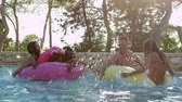 espanha : Group Of Friends On Inflatables In Outdoor Pool