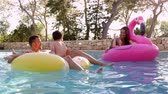 inflável : Family Having Fun On Inflatables In Outdoor Swimming Pool