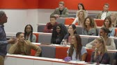 attention : Teacher addressing students in a university lecture theatre Stock Footage