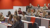 attention : University students applauding at the end of a lecture