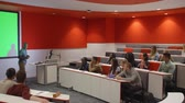 выше : Male teacher in lecture theatre presenting to students