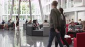 выше : Groups of students working together a university lobby, shot on R3D