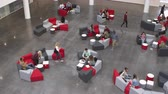 campus : Wide overhead shot of students in a busy university lobby