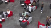 выше : Overhead shot of students in a busy university lobby