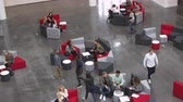 выше : Overhead handheld shot of students in university lobby Стоковые видеозаписи