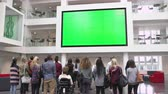 campus : Students under big AV screen in university atrium, back view Stock Footage