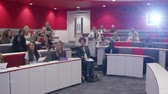 projetor : University students in discussion at a lecture theatre