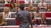 attention : University students applauding teacher at the end of lecture Stock Footage