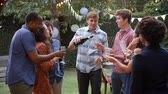 pacífico : Friends Celebrating With Champagne At Outdoor Backyard Party