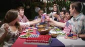 quarto : Friends Making A Toast To Celebrate 4th Of July Shot Stock Footage