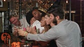 ocasião : Friends enjoying a Halloween party at a bar making a toast, shot on R3D