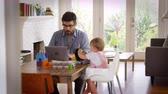 ojciec : Father Working From Home On Laptop As Son Plays With Toys