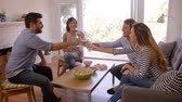 Couple Entertaining Friends At Home Shot In Slow Motion Stock mozgókép