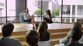 Two female speakers talking to audience at business seminar, shot on R3D