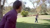 bolas : Seven year old boy throwing football with his dad in park