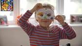 tendo : Portrait Of Girl Wearing Mask She Has Decorated At Home