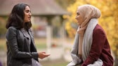 pakistani : Two British Muslim Women Meeting In Urban Park Stock Footage