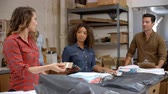 nativo americano : Team packing clothing orders for distribution Stock Footage