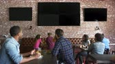 ponto : Friends Watching Game In Sports Bar On Screens Shot On R3D